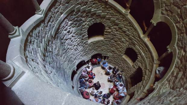 Crowds in a well at Quinta da Regaleira, Sintra, Portugal