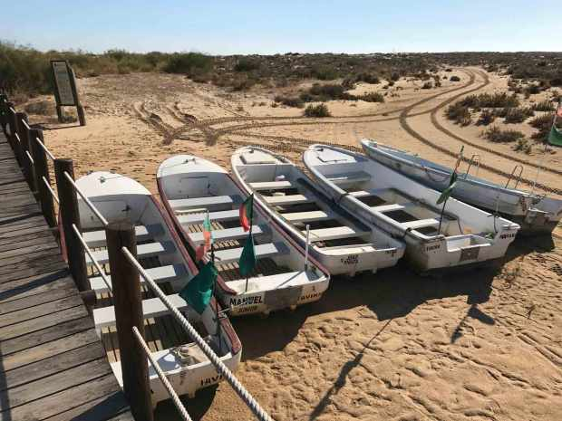 Boats along the elevated walkway to the beach from Cabanas town, Algarve, Portugal. Photo by Jill Kimball