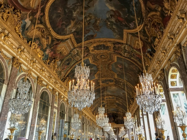 Chandeliers at the Hall of Mirrors in Versailles, Paris, photo by Jill Kimball
